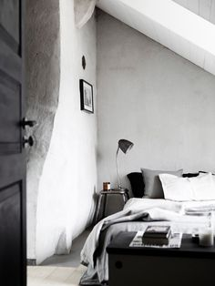A cave inspired bedroom in concrete gray hues. Designed by Johan Israelson, styled by Tina Hellberg and photographed by Johan Sellén.