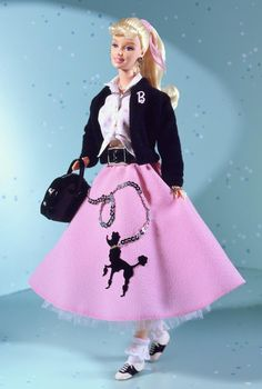 Nifty Fifties™ Barbie® Doll, I think this doll is super cute but i feel they tried to cram to much in it with the saddle shoes, pony tail, letterman sweater, belt, the ribbon, the poodle skirt, tied shirt, and the ankle socks