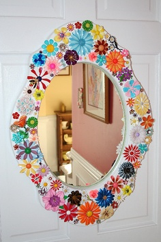 Brooches as mirror frame