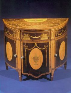 1775 An Early George III Demi-Lune Commode After a Design by Robert Adam and Possibly Executed by Thomas Chippendale Inlaid with Unusual Sycamore, Satinwood, and Fruitwood Marquetry in the Form of Urn, Garland, and Floral Decoration