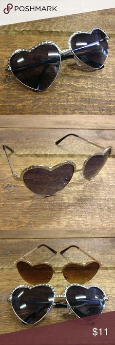 Silver Rhinestone Heart Eyes ?? Sunglasses NEW! Tortoiseshell Rhinestone Wayfarer Sunglasses NEW!  Festival season, spring, summer, peace, love and sunshine! It's right around the corner and you'll definitely need these statement shades!  Heart-shaped, wire frame, aviator style sunglasses  Rhinestones along top  Silver color (cool)  100% UV Protection  So cute and adorable! CLE Threads Accessories Sunglasses