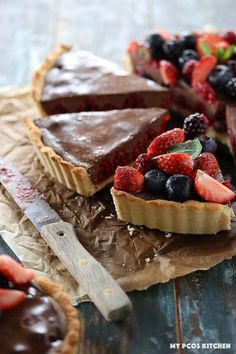 Low Carb No Bake Chocolate Tart with Raspberries - My PCOS Kitchen - A delicious dairy free and sugar free chocolate tart with raspberries on a gluten free almond flour pie crust. #lowcarb #chocolate #easter #chocolatetart #glutenfreebaking #sugarfree #dairyfree