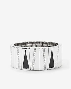 """Our leather stretch bracelet is an of-the-moment mix of shine and texture. Match it back to our long leather pendant or short leather necklace and earrings for maximum impact against the canvas of a little black dress or black leather moto jacket.  Black leather and silvertone stretch bracelet Approx. 2"""" Silvertone with leather; imitation rhodium; glass  Custom designed exclusively for WHBM. Handcrafted with nickel-free and lead-free metal."""