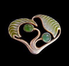 LEVINGER & BISSINGER A Jugendstil silver plique-a-jour brooch set with two chrysoprase stones.