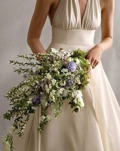 This dress is stunning and beautiful with this bouquet. The branches add more structure to the whole bouquet and the fact that they are full of flowers makes the whole look softer and more natural. This is a perfect bouquet idea for any spring brides! Wedding Reception Themes, Wedding Decorations, Wedding Ideas, Wedding Stuff, Wedding Shit, Martha Stewart Weddings, Wedding Bouquets, Wedding Flowers, Wedding Dresses