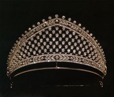 The Faberge tiara given to Crown Princess Cecilie when she married into the Prussian Royal House in 1905. Designed as a Russian kokoshnic, with a floral diamond lattice making up the main body of the tiara, with additional diamond bands incorporating laurel leaf motifs.