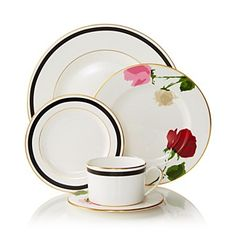 Everything's coming up roses in kate spade new york's classically styled china collection featuring painterly roses, black trim and sleek metallic edges. | Bone china | Dishwasher safe | Made in USA |