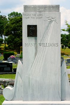 Hank Williams' grave in Old Oak Cemetery, Montgomery, Alabama, by Brian David Braun Photography, via Flickr.  Hank Williams (9/17/1923 – 1/1/1953), born Hiram King Williams, was an American singer-songwriter & musician. Regarded as 1 of the most significant country music artists, Williams recorded 35 singles (5 released posthumously) that placed in the Top 10 of Billboard Country/Western Best Sellers chart, including 11 that ranked #1. Williams was born in Mount Olive, Butler County…