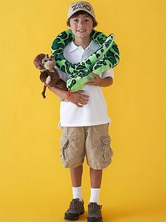 "Need an idea for a costume you can make in nearly no time at all? Dig into your child's stuffed animal stash to create a clever zookeeper costume. Simple khaki shorts, a white polo shirt, a ball cap decorated with a ""Zoo"" label, and stuffed animals attached to the clothing with safety pins or hook-and-loop tape are all that you need to tame this look."