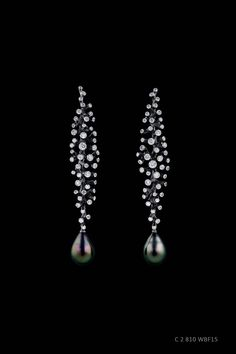 Jewellery Theatre white gold Coral earrings featuring 95 diamonds and two black Tahitian pearls