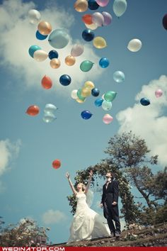 Bride and groom put their vows to one another in a balloon after the ceremony and then let them go. Cute and unique