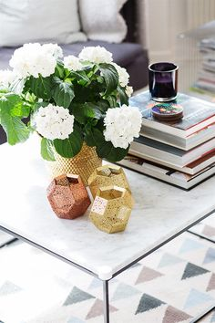 marble table, white hydrangeas + TD etch candleholders