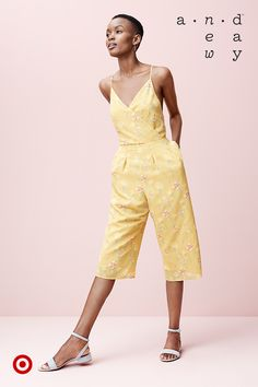 Say hello to warm weather in this breezy floral jumpsuit with wrap-front detail.