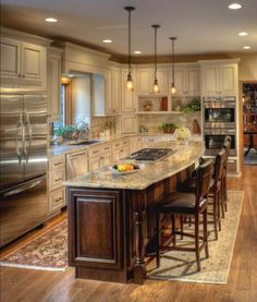 Have to do a similar kitchen layout, with the majority on one wall Ivory cabinets with a chocolate glaze coordinate well with the Cherry Espresso island. Kitchen designed by Stefanie Ciak of J. Brown & Co. Photography by Michael Houghton Kitchen Redo, New Kitchen, Kitchen Ideas, Kitchen Small, Long Narrow Kitchen, Design Kitchen, Kitchen Bars, Ranch Kitchen, Awesome Kitchen