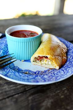 Easy Calzones via @Ree Drummond | The Pioneer Woman. I think it's fun to have the set up ready and let people build their own with veggies, meats, cheeses, etc. Great for a small party!