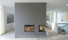 concept is good -- Scandinavian architecture firm C. Møller designed a serene, zinc-clad home in Aarhus, Denmark. On the interior, a large, three-sided fireplace incorporated into a floating wall helps connect two spaces and warm up the home. House Design, Contemporary Fireplace, Modern Fireplace, Loft Spaces, Interior Architecture, Minimalist Home, Clad Home, Modern House, Fireplace Design