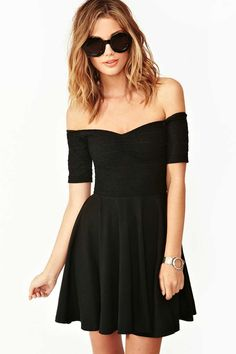 Off-the-shoulder black skater dress featuring a gathered neckline and textured top.