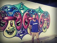 Artist Kenny Scharf and Mural.jpg