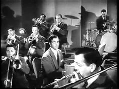"""""""In the Mood"""" by the Glenn Miller Orchestra -- mostly. I don't believe John Payne ever played piano for Glenn Miller. This is taken from the movie, """"Sun Valley Serenade"""" The cute blonde is Sonja Henie, an Olympic champion skater but not a great actress. Glenn Miller, Sound Of Music, Good Music, 50s Music, Jazz Music, John Payne, Jazz Blues, Blues Music, Actor John"""