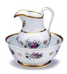 GILT DECORATED PORCELAIN PITCHER AND WASH BASIN.