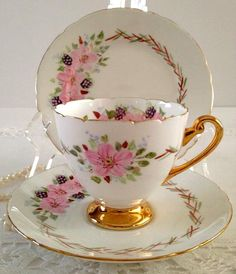 Gold And Pink Tea Cup And Saucer