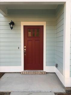 Siding: Sherwin williams rainwashed   Front door: Sherwin williams crabby Apple Trim: sherwin williams alabaster Front Door Paint Colors, Exterior Paint Colors For House, Painted Front Doors, Paint Colors For Home, Saltbox Houses, House Front Door, House Color Schemes, Cottage Exterior, Florida Home