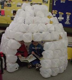 Milk jug igloo! I made one of these before, and it lasted months in a room of preschoolers. We decorated it for different themes (cave, beach hut, etc.). My advice would be to be ready with a lot of hot glue, to make sure jugs are washed out well and totally dry, and to glue on the tops (children will love to stuff toys, tissues, and who knows what else into them otherwise!)