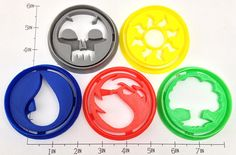 Set of 5 cookie cutters in the mana symbols for Magic the Gathering! Make Magic cookies and eat them while playing with your friends. - Home-made - 3D Printed with ABS - Dishwasher safe Plastic cookie