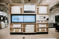 Innovation and quality are best experienced in a showroom—firsthand. Nothing can replace running your hand over silky soft sheets, laying your head on the new ActiveDough™ pillow, or meeting the people behind every email. At Malouf, we're constantly creating new products and bolstering existing items to offer a full range of sleep goods that deliver personalized comfort for every sleep style. We look forward to your next visit! Retail Interior Design, Retail Store Design, Retail Shelving, Linen Store, Store Displays, Boutique Design, Shop Interiors, Display Design, Showroom