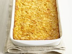 Corn Pudding Recipe : Food Network Kitchens : Food Network - FoodNetwork.com   Maybe 1/2 the onion next time and dice smaller.  or use chives    don't use short and deep dish   takes too long to bake     Tastes great with my sweet potato black bean chili!
