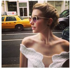 the shades, the braids, the dress   Emma Roberts