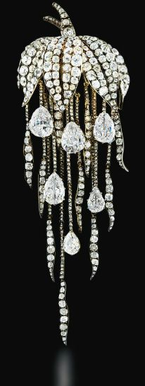 A SUPERB ANTIQUE DIAMOND BROOCH  Of naturalistic design, the pavé-set old-cut diamond leaf canopy suspending a graduated fringe of diamond trails with six pear-shaped diamond drops, mounted in silver and gold, brooch circa 1860, diamond drops late 18th century, 12.7 cm long #DiamondBrooches