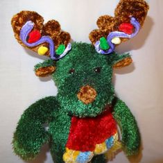 Green reindeer with Christmas lights on the antlers. It has a scarf. Green Christmas Lights, Black Teddy Bear, Turtle Plush, Misfit Toys, Animal Pillows, Christmas Toys, Dinosaur Stuffed Animal, Stuffed Animals, Pet Gifts