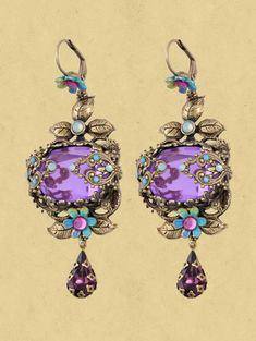 "Michal Negrin is launching a new jewelry collection ""True Colors"" ,The New Collection has dramatic and glamorous look with an emphasis on bold colors ,interesting and unique materials that create an unusual collection. Michal Negrin earrings with bold colors sparkling Swarovski crystals. The earrings measure2.8 inch long and the roses measure 1/2 inch in diameter. Nickel-free brass."