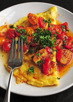 Zhong-Xi Breakfast ...east meets west. omelet with tomatoes in a garlic ginger soy sauce. gonna give this a try soon!