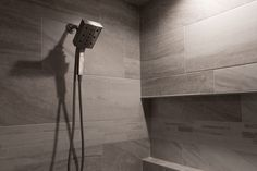 Shower Tile: Angora Evolution 12x24 and Mosaics; Grout: Warm Gray