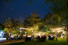 Rancho Las Lomas | Lighting bistro lights at casa bella outdoor dining evening