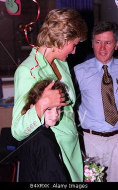 June 30, 1996: Princess Diana with her arm around Danielle Stephenson on a visit to a children s hospital during National Heart Week Lime Green jacket