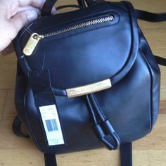 Marc by Marc Jacobs leather backpack Black comes with dust bag and tags. Clasp closure adjustable straps small pocket on the outside small pocket on the inside 2 cell phone  size pockets on the inside Marc by Marc Jacobs Bags Backpacks