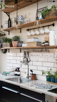 Classic kitchen: White subway tile, dark grout, open wood shelves, black lower cabinets.