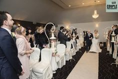 The bride walks down the aisle to her spiritualist ceremony. Weddings at Tulfarris Hotel & Golf Resort, photographed by Couple Photography.