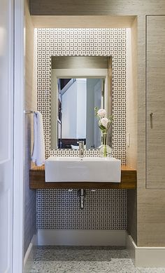 Contemporary Powder Room. bathroom design. tiles, stone. marble. wallpaper, shower. bathtub. ceiling. lighting. glass. sanitary fittings and...