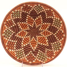 Rural weavers in Rwanda of all tribes, including Hutus and Tutsis, work side by side to produce these finely woven baskets