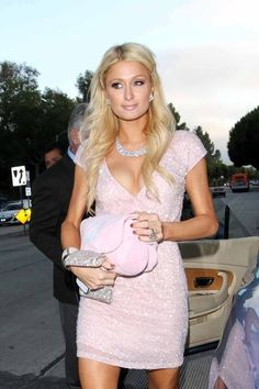 Paris Hilton, in a gorgeous baby pink dress. I love the diamond accesories.