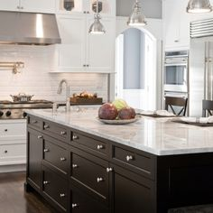Two toned kitchen.  I love the simplicity of the cabinet doors, and I love the drawer space!  I'd go with a creamy color instead of white, though.