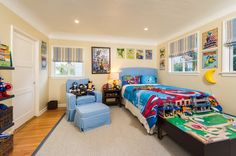 Image from http://chapar.co/wp-content/uploads/2015/04/toddler-boys-superhero-bedroom-ideas-and-colourful-boys-room-decor-ideas-with-cartoon-wall-art-on-beige-wall-and-light-blue-headboardand-colorful-bedding-with-light-blue-armchair-and-ottoman-on-area-r.jpg.