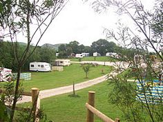 the caravan site showing touring caravans and mountains of north wales