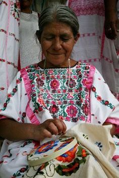 An indigenous Amuzgo woman embroiders a blouse in San Pedro Amuzgos, the main center for embroidery in the Mixteca region of Oaxaca, one of the poorest areas in Mexico. The women have set up a cooperative of embroiderers here. Indigenous Amuzgo, Mixtec, T Mexican Embroidery, Folk Embroidery, Embroidery Designs, Mexican Style, Mexican Folk Art, San Pedro, Mexican Textiles, Mexican Heritage, Mexican Designs