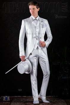 Baroque white jacquard frock coat with peak lapels and crystal brooch. Wedding suit 1869 Baroque Collection Ottavio Nuccio Gala.