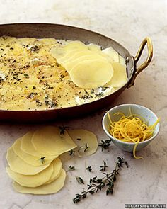 Lemon-and-Thyme Potato Gratin ~ Thin slices of Yukon gold potatoes are layered with fresh thyme, lemon zest, and a whisper of freshly grated nutmeg. The potatoes are covered with just enough milk to immerse them, and then baked until tender and bubbly.